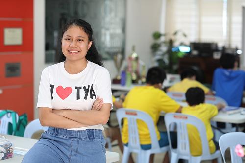 Youth volunteer brings fun and joy to children